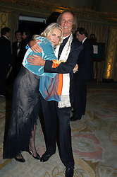 MRS GAEL BOGLIONE and MR ROGER TAVERNER at the Chain of Hope Autumn Ball Fiesta held at The Dorchester, Park Lane, London on 6th October 2004.