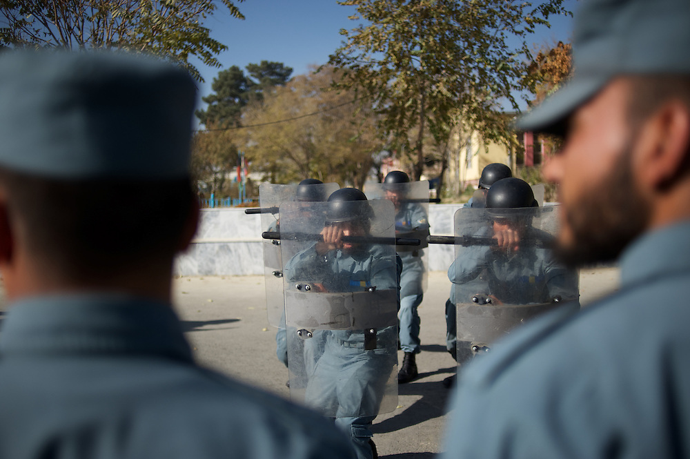 November 14, 2012 - Kabul, Afghanistan: Afghan National Police (ANP) cadets train riot control during morning exercises at the Afghan Nacional Police Academy...ANP Academy trains 1250 cadets at the time during a period of four years. Every year, five hundred new recruits are selected, out of more than nine thousand of candidates, to join the academy and other five hundred graduate. Fifteen per cent of the recruits are women. (Paulo Nunes dos Santos)