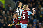 Newcastle United forward Joselu Mato Sanmartin (21) challenges with Burnley defender Ben Mee (6) in the air  during the Premier League match between Burnley and Newcastle United at Turf Moor, Burnley, England on 30 October 2017. Photo by Simon Davies.