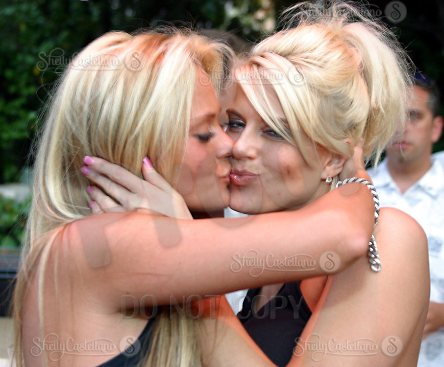 Jul 09, 2002; Los Angeles, CA, USA; Kissing cyber playmates CARRIE A. TAYLOR, MI (left) and AMY MILLER, PA (right) as SUGAR RAY LEONARD BOXING first year anniversary was celebrated with a live fight night on ESPN2 from the Playboy Mansion in Holmby Hills.  Over 350 invited guests attended the cocktail reception and showdown in the back yard of Playboy HUGH HEFNER's 5 1/2 acre estate. <br />Mandatory Credit: Photo by Shelly Castellano/ZUMA Press.<br />(&copy;) Copyright 2002 by Shelly Castellano