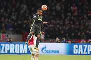 Alex Sandro of Juventus heads the ball during the Champions League Quarter-Final Leg 1 of 2 match between Ajax and Juventus FC at the Amsterdam Arena, Amsterdam, Netherlands on 10 April 2019.