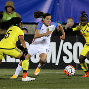 Tobin Heath, USA, dribbles between Liana Salazar, (left) and Leidy Asprilla, Colombia, during the USA Vs Colombia, Women's International friendly football match at the Pratt & Whitney Stadium, East Hartford, Connecticut, USA. 6th April 2016. Photo Tim Clayton