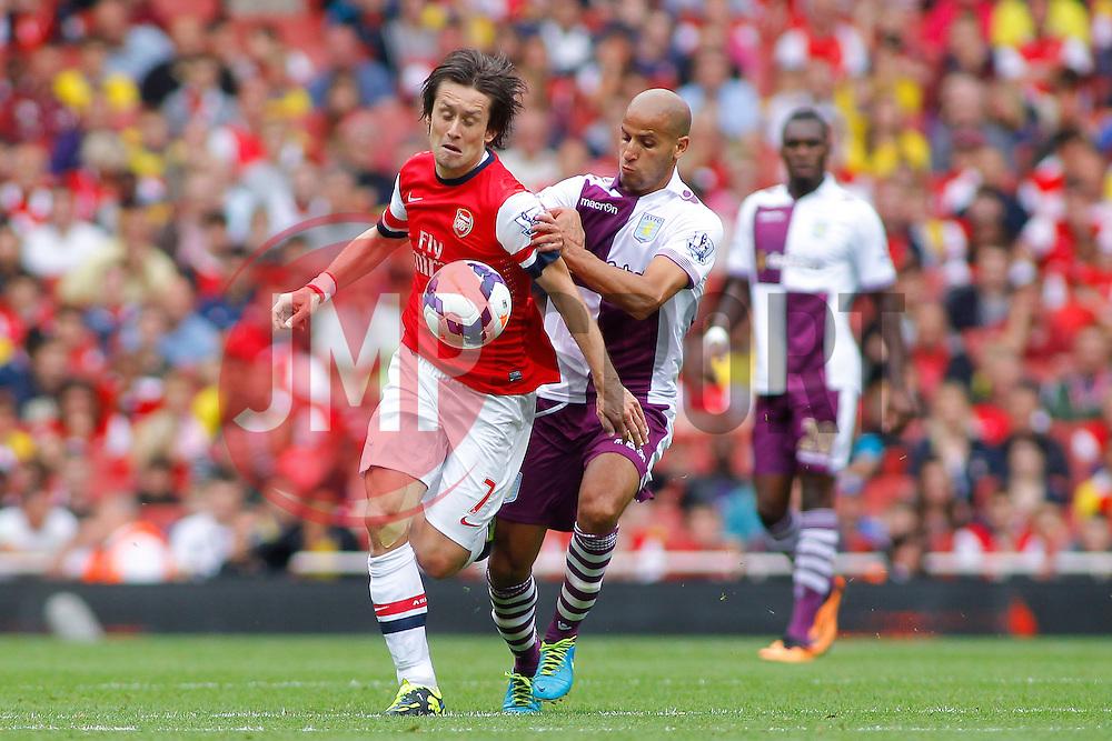 Arsenal's Tomas Rosicky  is fouled by Aston Villa's Karim El Ahmadi  - Photo mandatory by-line: Mitch Gunn/JMP - Tel: Mobile: 07966 386802 17/08/2013 - SPORT - FOOTBALL - Emirates Stadium - London -  Arsenal V Aston Villa - Barclays Premier League