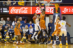 Jan 20, 2016; Morgantown, WV, USA; West Virginia Mountaineers guard Daxter Miles Jr. (4) drives baseline during the second half against the Texas Longhorns at the WVU Coliseum. Mandatory Credit: Ben Queen-USA TODAY Sports