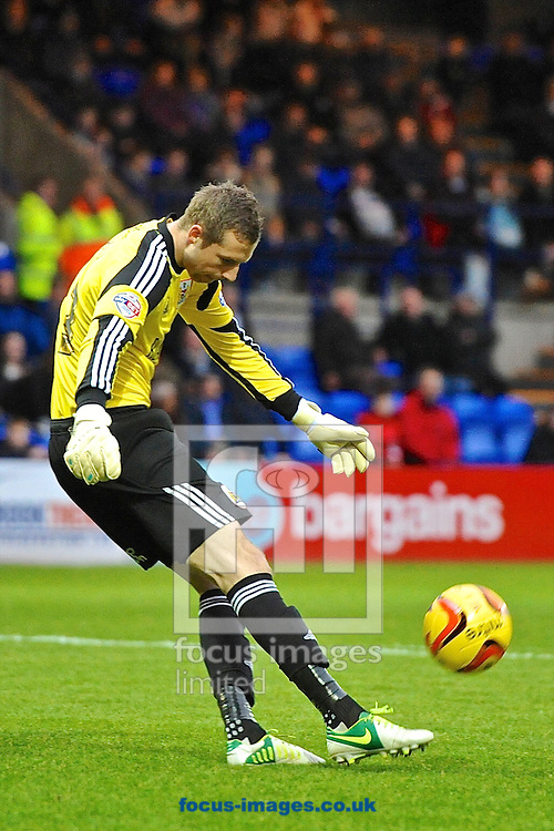 Picture by Ian Wadkins/Focus Images Ltd +44 7877 568959<br /> 16/11/2013<br /> Elliott Parish of Bristol City kicks clear during the Sky Bet League 1 match at Prenton Park, Birkenhead.