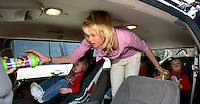 After attending a session at The Music Class with her children, sports agent Molly Fletcher puts her daughters in a van with the help of nanny Dottie Page (in driver's seat) on Wednesday, March 22, 2006 before heading away to a lunch meeting. Fletcher juggles a busy family life with her more than full-time job representing several top sports personalities.