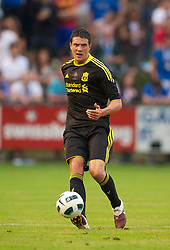 ZUG, SWITZERLAND - Wednesday, July 21, 2010: Liverpool's Martin Kelly in action against Grasshopper Club Zurich during the Reds' first preseason match of the 2010/2011 season at the Herti Stadium. (Pic by David Rawcliffe/Propaganda)