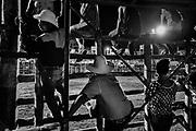 "Brasilito - February 2019 - Ticos have developed their own version of bull fighting where the bull is the aggressor and the ""improvised bullfighters"" try to get as close as possible without injury. But, there will be a real cowboy who rides, or attempts to ride a bull.<br /> The riders names are drawn against the bulls. When the riding finally starts it's a fast moving affair. A new bull is sent out just a soon as they round up the previous one.<br /> The bulls are allowed to run free for a couple of minutes after they are ridden to chase those brave enough to stay in the ring. The bullfights in Costa Rica go back to the colonial era, when they emerged together with the development of livestock and Spanish influence. Although the bull cannot be killed, Costa Rica remains one of the few Latin American countries that preserves the tradition of bullfighting. <br /> ©Jean-Michel Clajot"