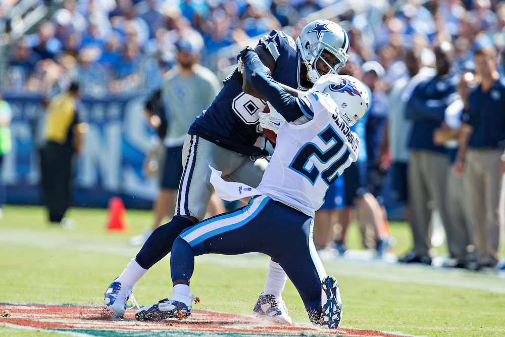 NASHVILLE, TN - SEPTEMBER 14:  Dez Bryant #88 of the Dallas Cowboys pushes off the tackle of Coty Sensabaugh #24 of the Tennessee Titans at LP Field on September 14, 2014 in Nashville, Tennessee.  The Cowboys defeated the Titans 26-10.  (Photo by Wesley Hitt/Getty Images) *** Local Caption *** Dez Bryant; Coty Sensabaugh