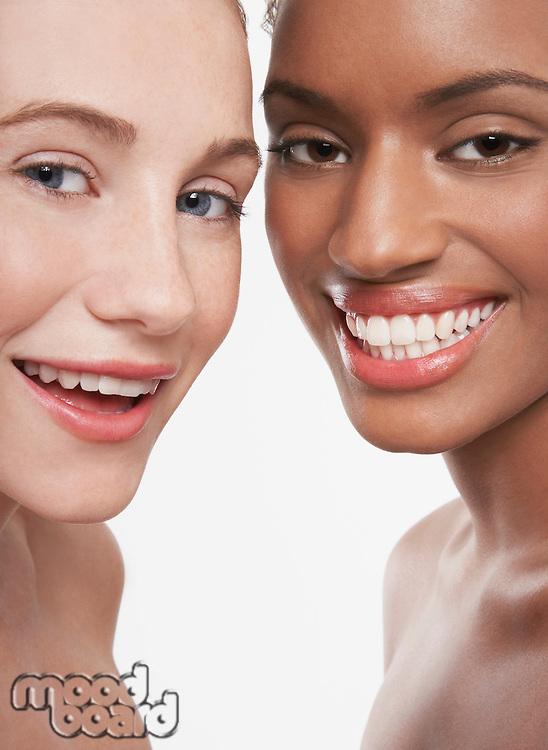 Two beautiful young women smiling