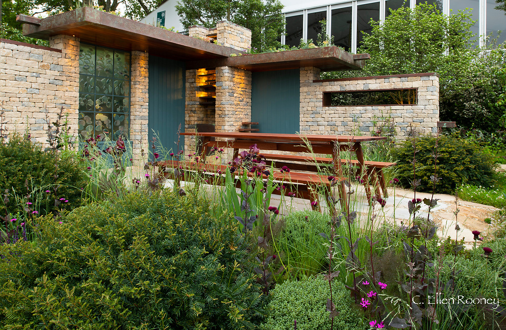 A Frank Lloyd Wright style building creating a courtyard in the Warner's Distillery Gin Garden at the RHS Chelsea Flower Show 21019