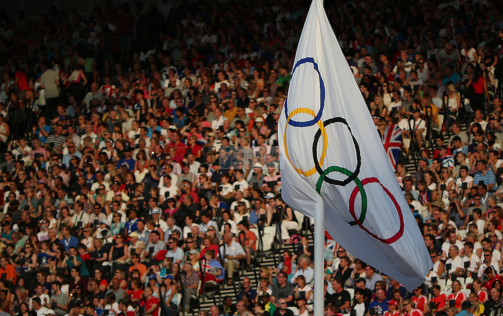 The Olympic flag flies during track and field at the Olympic Stadium during day 13 of the London Olympic Games in London, England, United Kingdom on August 9, 2012..(Jed Jacobsohn/for The New York Times)..