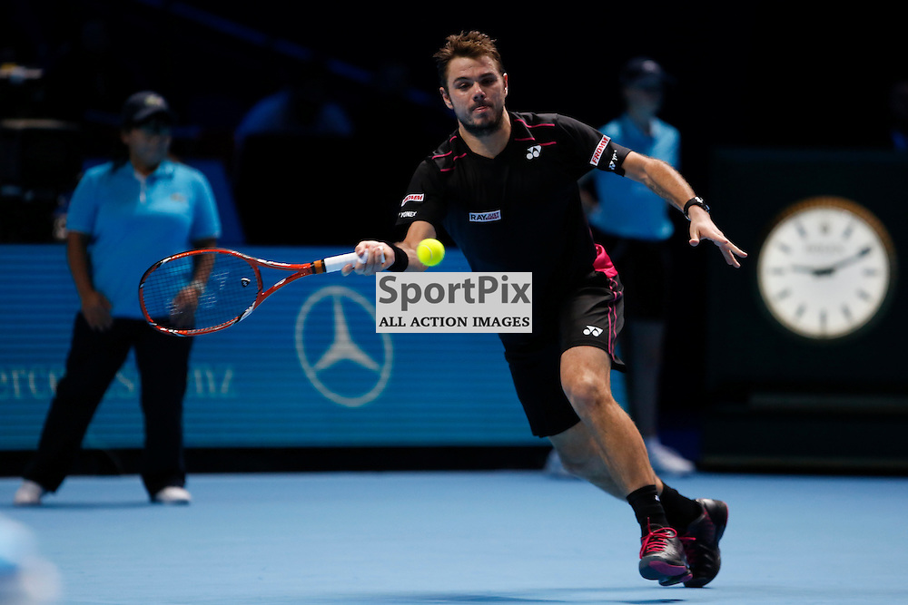 Stan Wawrinka stretches to return the ball during a match between Stan Wawrinka and David Ferrer at the ATP World Tour Finals 2015 at the O2 Arena, London.  on November 18, 2015 in London, England. (Credit: SAM TODD | SportPix.org.uk)