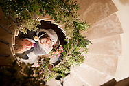 Bride and groom looking up through spiral staircase