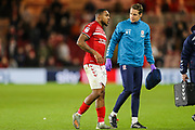 Middlesbrough forward Britt Assombalonga (9) hobbles off the pitch injured following a tackle from Charlton Athletic midfielder Darren Pratley (15) during the EFL Sky Bet Championship match between Middlesbrough and Charlton Athletic at the Riverside Stadium, Middlesbrough, England on 7 December 2019.