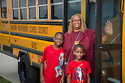 Houston ISD bus driver Shirley McBride poses for a photograph with students, July 16, 2014.