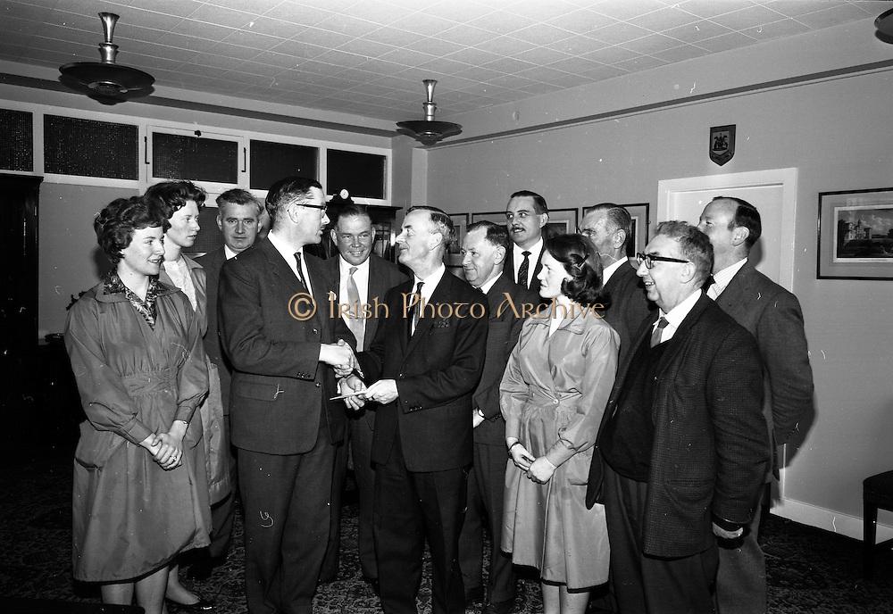 14/05/1965<br /> 05/14/1965<br /> 14 May 1965<br /> Irish Shell staff presentation at offices on Fleet Street, Dublin. On left making the presentation is Mr B.A. Nolan, Managing Director of Irish Shell.