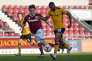 Northampton Town Striker John Marquis battles Newport County Defender Janoi Donacien during the Sky Bet League 2 match between Northampton Town and Newport County at Sixfields Stadium, Northampton, England on 25 March 2016. Photo by Dennis Goodwin.