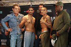 Amir Khan (centre left) and Samuel Vargas (centre right) during the weigh in at Arena Birmingham.