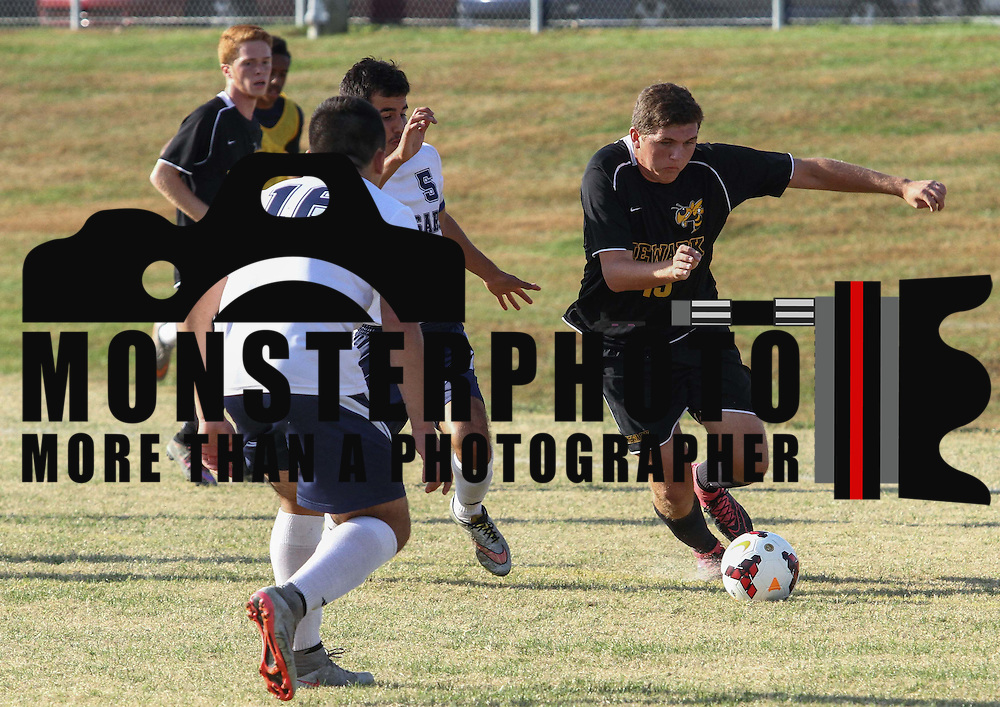 Newark FC Forward Brandon Pellegrini (13) dribbles the ball pass Newark defenders during a regular season soccer match between Newark and Delcastle Thursday, Oct. 22, 2015 at Delcastle in Wilmington.