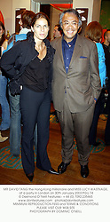 MR DAVID TANG the Hong Kong millionaire and MISS LUCY WASTNAGE, at a party in London on 30th January 2003.	PGU 74