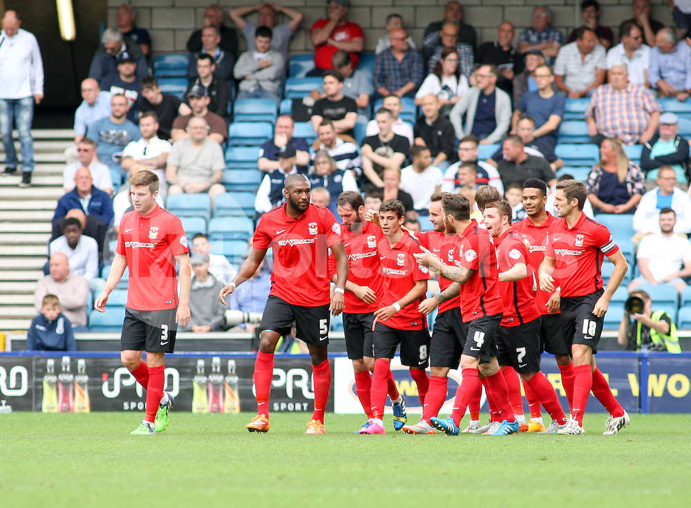 Ruben Lameiras of Coventry City (number 8) is congratulated after making it 2-0 during the Sky Bet League 1 match between Millwall and Coventry City at The Den, London, England on 15 August 2015. Photo by Edmund  Boyden.