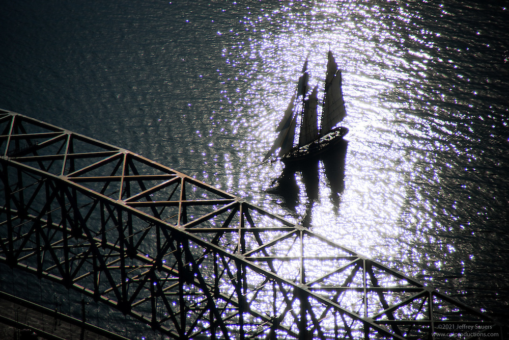 Silhouette of Tall Ship at Key Bridge Artistic aeial image of schooner sailing with full sail.Fine Art Image