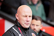 A wink from Walsall manager Jon Whitney before the EFL Sky Bet League 1 match between Walsall and Peterborough United at the Banks's Stadium, Walsall, England on 16 September 2017. Photo by Nigel Cole.