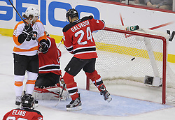 May 3, 2012; Newark, NJ, USA;  Philadelphia Flyers defenseman Matt Carle (25) scores a goal past New Jersey Devils goalie Martin Brodeur (30) during the second period in game three of the 2012 Eastern Conference semifinals at the Prudential Center.