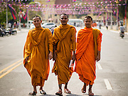 25 FEBRUARY 2015 - PHNOM PENH, CAMBODIA:  Buddhist monks walk along Sothea Ros Road in Phnom Penh.   PHOTO BY JACK KURTZ