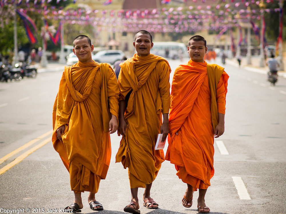 25 FEBRUARY 2015 - PHNOM PENH, CAMBODIA:  Buddhist monks walk along Sothea Ros Road in Phnom Penh.   PHOTO BY JACK KURTZ