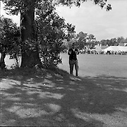"""20/07/1962<br /> 07/20/1962<br /> 20 July 1962<br /> Woodbrook Irish Hospitals' Golf Tournament at Woodbrook Golf Course, Dublin. """"I'm in enough trouble without photographers"""" said Kel Nagle when he found himself on the wrong side of  this tree on the 2nd."""