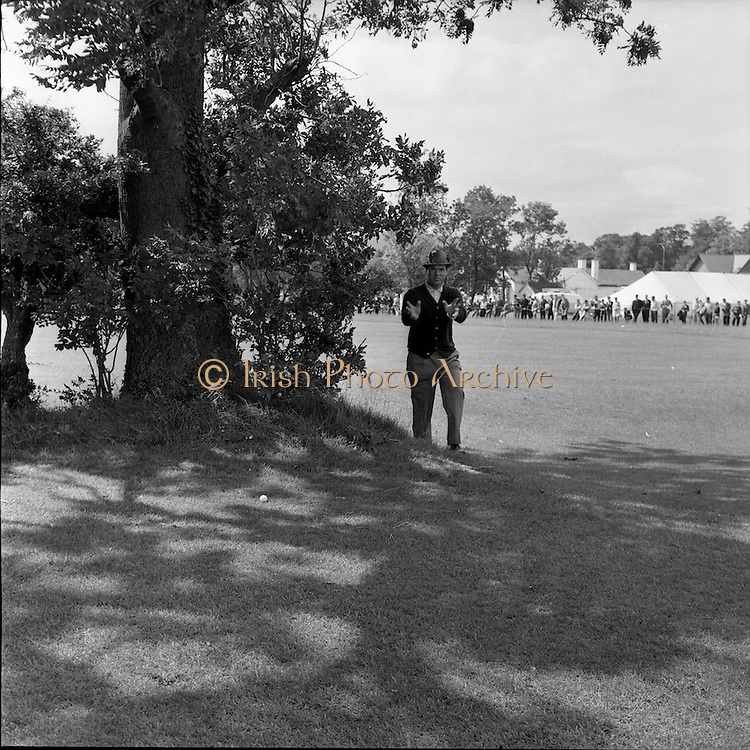 "20/07/1962<br /> 07/20/1962<br /> 20 July 1962<br /> Woodbrook Irish Hospitals' Golf Tournament at Woodbrook Golf Course, Dublin. ""I'm in enough trouble without photographers"" said Kel Nagle when he found himself on the wrong side of  this tree on the 2nd."