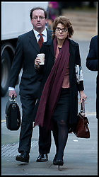 Vicky Pryce arrives for the start of her Trial with her ex husband the former energy secretary Chris Huhne over aspeeding penalty. The former couple are both accused of perverting the course of justice. It is alleged that Huhne persuaded Pryce to take his penalty points for a speeding offence in 2003, South Crown Court, London, Monday February 4, 2013. Photo By Andrew Parsons / i-Images