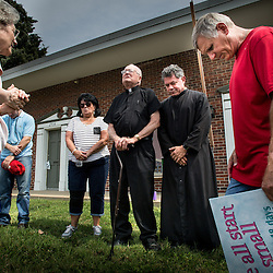 Lisa Johnston | lisajohnston@archstl.org  | Twitter: @aeternusphoto  Mary Maschmeier, founder of Defenders of the Unborn, organized  a protest in front of Pathology Services Inc. on Brentwood Blvd. She stood with Father Donald Buhr from Seven Holy Founders Parish and Father Jack Siefert of St. Mary Magdalen Parish in Brentwood as the protesters gathered for prayer.   Pathology Services Inc. is employed by Planned Parenthood of St. Louis to examine the babies who have been aborted.  About three dozen protesters stood along the busy corridor in St. Louis in 95 degree heat wanting to know what happens to the baby remains after they are examined inside the building.