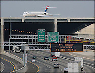 A Delta Airlines plan  rolls down the newly opened 5th runway over Interstate 285  at Hartsfield Jackson International Airport on March 26, 2009.  ©2009 Johnny Crawford