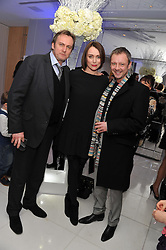 Left to right, PHILIP GLENISTER, KEELEY HAWES and JOHN SIMM at the pre party for the English National Ballet's Christmas performance of The Nutcracker held at the St.Martin's Lane Hotel, St.Martin's Lane, London on 14th December 2011.