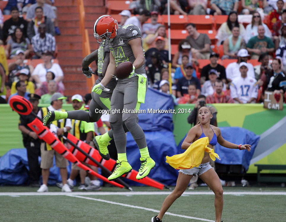 Samoan heritage Cleveland Browns Tight End, Jordan Cameron (mother is Cathy Cravens) celebrates his TD as a streaker dashes by during the NFL Pro Bowl, Aloha Stadium, Honolulu, Hawaii.  1/26/14, Photo by Abe Markowitz, Courtesy STP/TriMarine