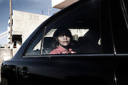 Cape Verde, Island of Santiago, city of Praia. The Government of Cape Verde has 8 Ministers in a cabinet of 15. Minister of the Reform of the State and of the National Defence, Maria Cristina Lopes Almeida Fontes Lima, in the official car outside her house in the morning.