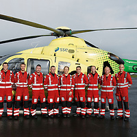 FREE TO USE PHOTOGRAPH....30.10.15<br /> Scotland's Charity Air Ambulance (SCAA) unveiled it's new helicopter at Perth airport this morning a EC135 T2i (pictured) which replaces the Bolkow 105 helicopter which is retiring from service. The new helicopter will increase speed, range, endurance and payload, allow SCAA to fly at night and in cloud. The Paramedic team from left, Phillip Campbell, Mark Tynan, Craig McDonald, Chris Darlington, Julia Barnes, Paul Gowans, Alan Finlayson, John Salmond and Lead Paramedic John Pritchard.<br /> for further info please contact Maureen Young on 07778 779000<br /> Picture by Graeme Hart.<br /> Copyright Perthshire Picture Agency<br /> Tel: 01738 623350  Mobile: 07990 594431