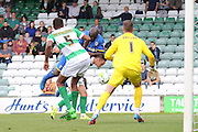 Bayo Akinfenwa of AFC Wimbledon tries to find a way through during the Sky Bet League 2 match between Yeovil Town and AFC Wimbledon at Huish Park, Yeovil, England on 12 September 2015. Photo by Stuart Butcher.