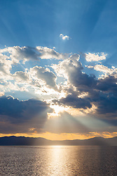 """""""Crepuscular Rays Over Lake Tahoe 2"""" - These crepuscular rays were photographed near sunrise over Lake Tahoe. Shot from a small fishing boat during the annual Jakes on the Lake charity fishing derby."""