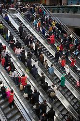 Escalators carrying passengers to trains inside Beijing West Railway Station China 2009