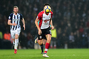 Southampton striker Guido Carrilo (9) sprints forward with the ball as it obscures his face during the Premier League match between West Bromwich Albion and Southampton at The Hawthorns, West Bromwich, England on 3 February 2018. Picture by Dennis Goodwin.