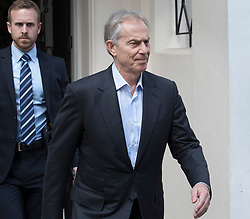 """© Licensed to London News Pictures. 06/07/2017. London, UK. Former Prime Minister Tony Blair (R)  is seen in central London. Earlier, Sir John Chilcot , head of the Iraq Inquiry, gave an interview in which he said Mr Blair was not """"straight with the nation"""" in his decisions in the run up to the Iraq war.  Photo credit: Peter Macdiarmid/LNP"""