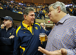 Jan 27, 2018; Morgantown, WV, USA; United States Senator Joe Manchin talks with West Virginia Mountaineers fans before the game against the Kentucky Wildcats at WVU Coliseum. Mandatory Credit: Ben Queen-USA TODAY Sports