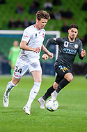 Western Sydney Wanderers defender Patrick Ziegler (34) runs the ball downfield at the FFA Cup quarter-final soccer match between Melbourne City FC and Western Sydney Wanderers FC at AAMI Park in Melbourne.