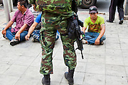 20 MAY 2010 - BANGKOK, THAILAND: Thai soldiers men who did not have their ID cards during mopping up operations Thursday near the Ratchaprasong Intersection in Bangkok Thursday. The men were ultimately released. The day after a military crackdown killed at least six people, Thai authorities continued mopping up operations around the site of the Red Shirt rally stage and battle fires set by Red Shirt supporters in the luxury malls around the intersection. PHOTO BY JACK KURTZ