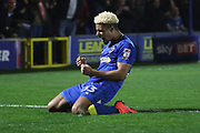 AFC Wimbledon striker Lyle Taylor (33) celebrating after scoring goal to make it 1-0 during the EFL Sky Bet League 1 match between AFC Wimbledon and Charlton Athletic at the Cherry Red Records Stadium, Kingston, England on 10 April 2018. Picture by Matthew Redman.