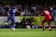 AFC Wimbledon midfielder Liam Trotter (14) passing the ball during the EFL Sky Bet League 1 match between AFC Wimbledon and Walsall at the Cherry Red Records Stadium, Kingston, England on 21 August 2018.